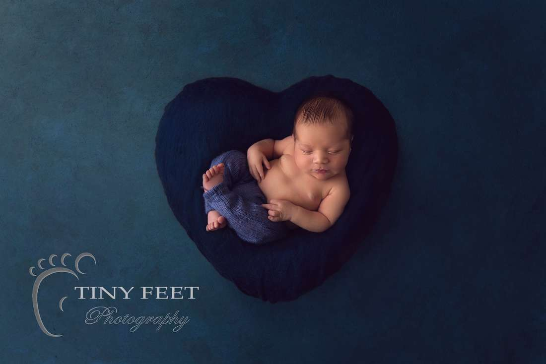 Tiny Feet Photography baby boy posed on blue digital backdrop heart