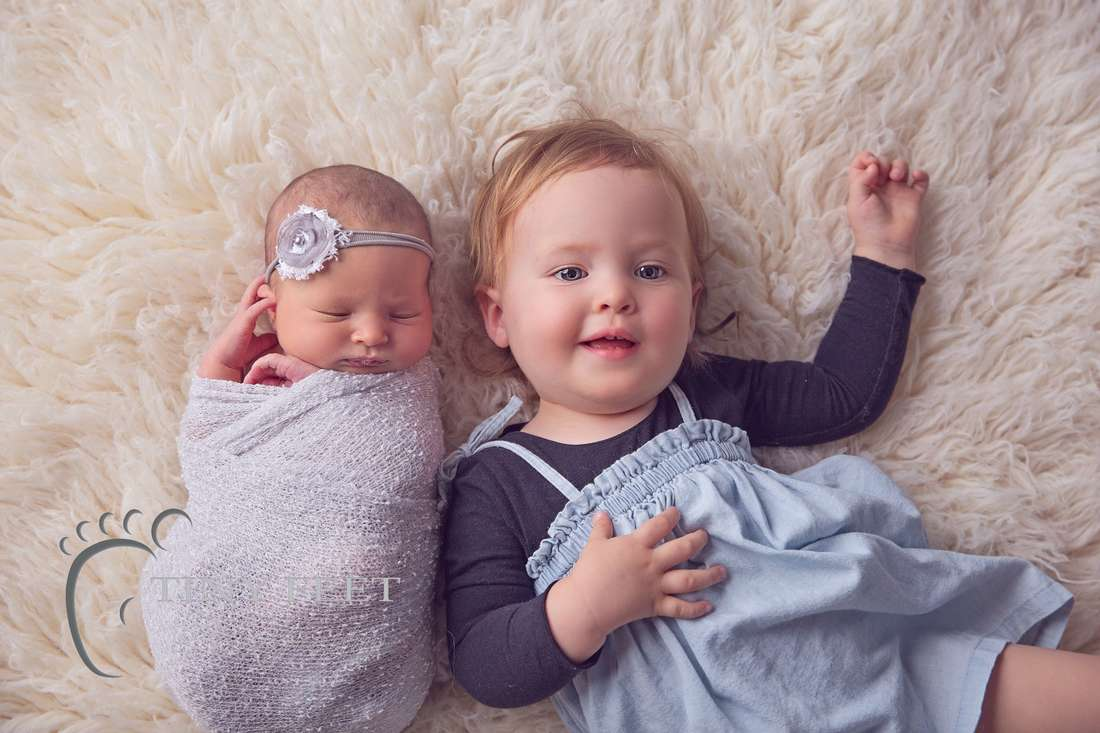Tiny Feet Photography newborn baby posed with 18month old sibling