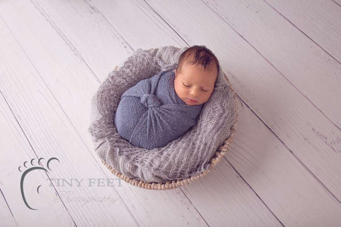 Tiny Feet Photography Newborn baby boy posed in grey wrap in bowl