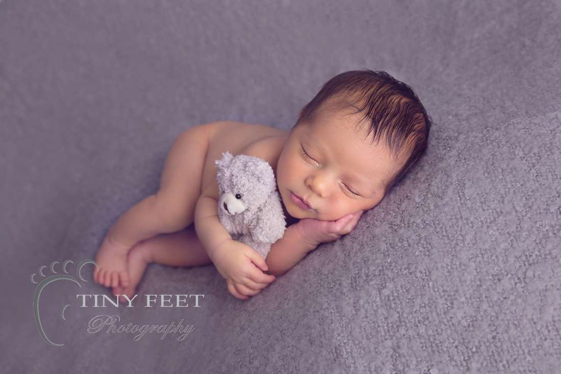 Tiny Feet Photography baby boy in side pose on grey blanket