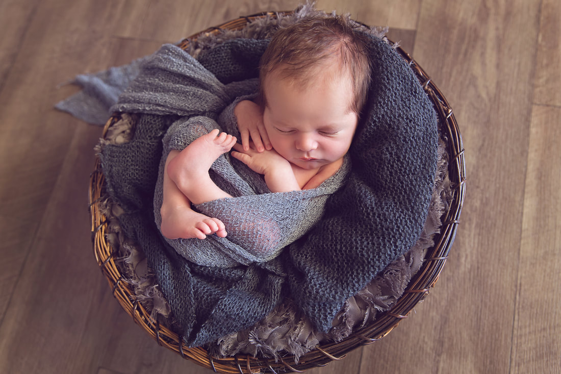 Tiny Feet Photography Newborn baby boy in brown basket with black fluff