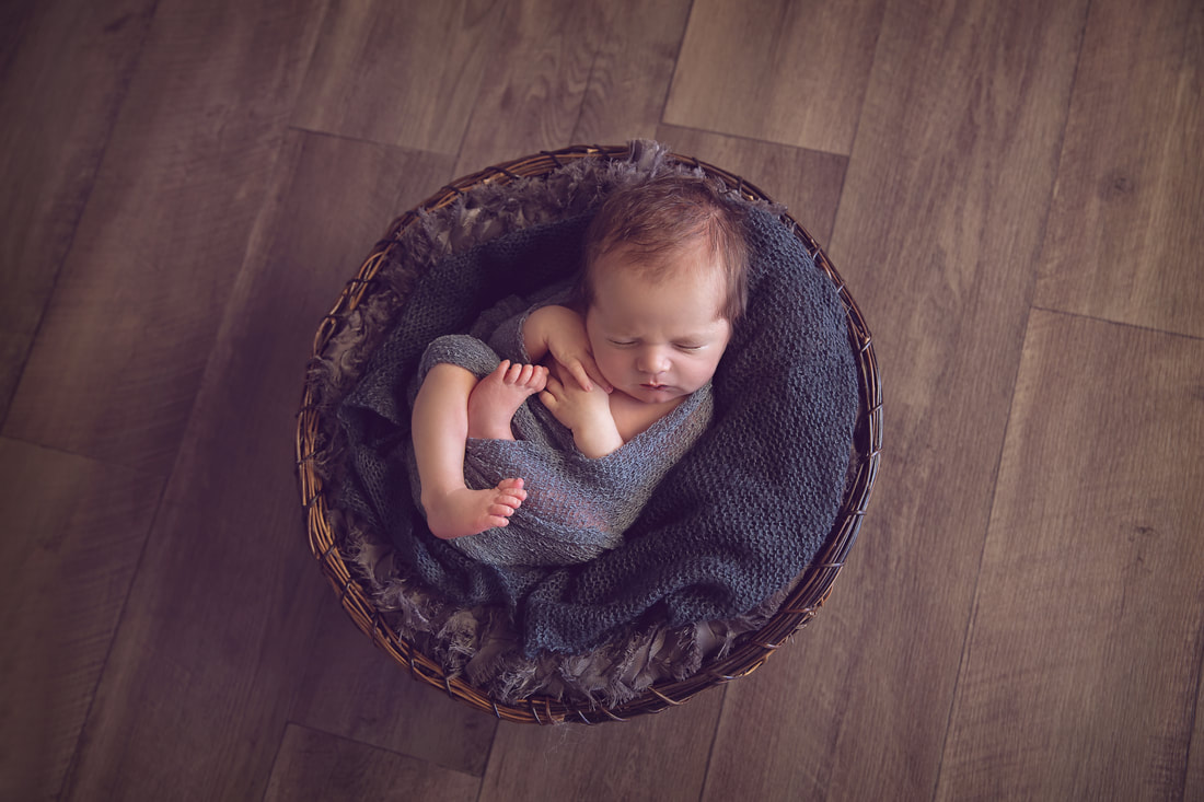 Tiny Feet Photography Newborn Baby boy in basket on black and grey fluff
