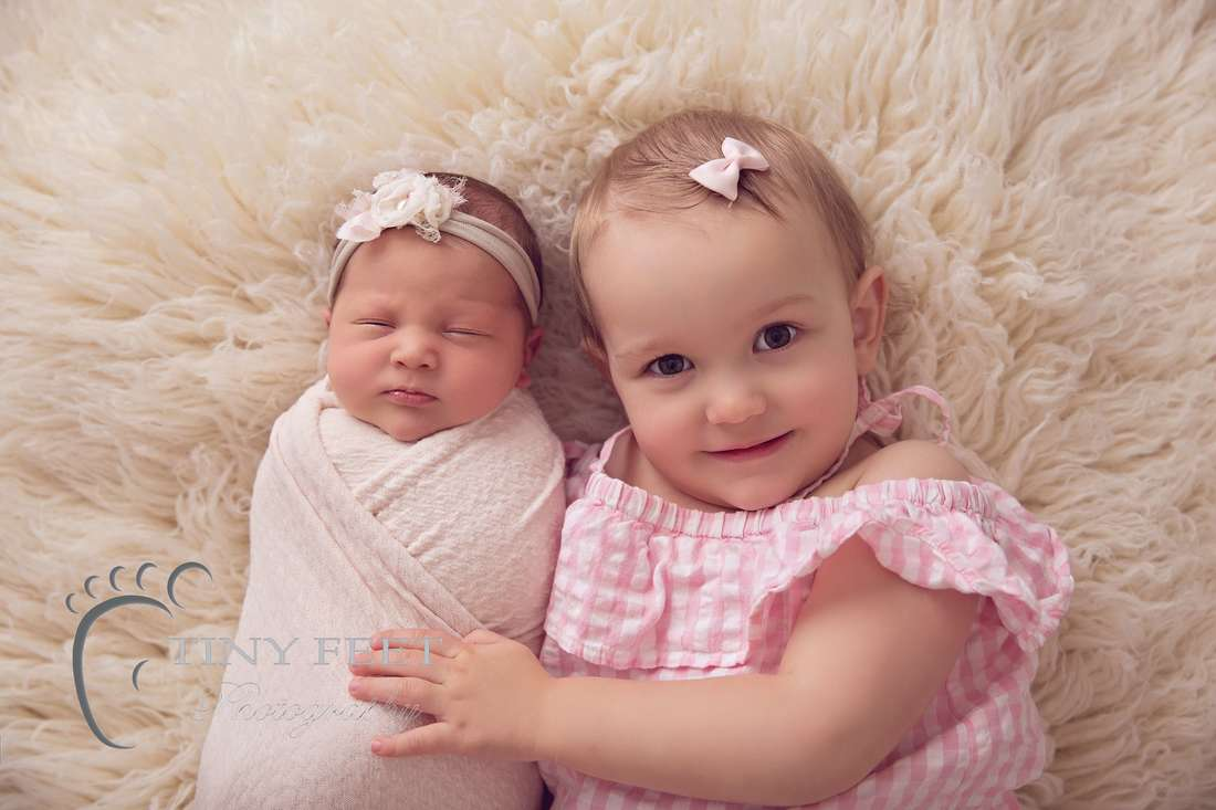 Tiny Feet Photography baby girl posed with 2 year old sibling