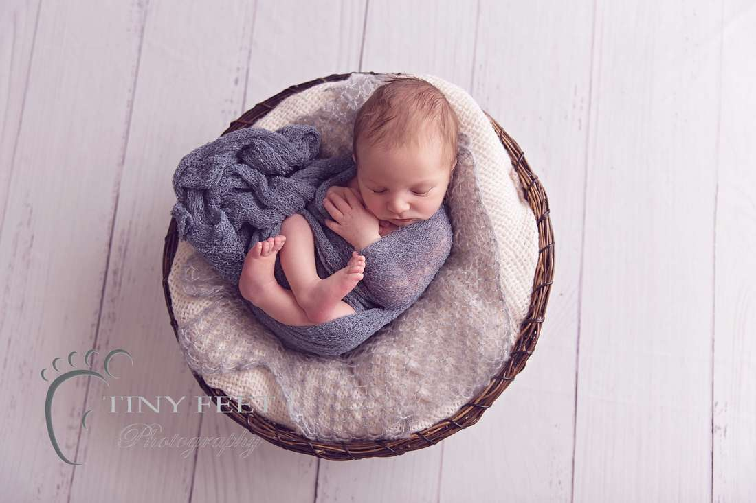 Tiny Feet Photography baby boy wrapped in grey wrap in cream and brown basket