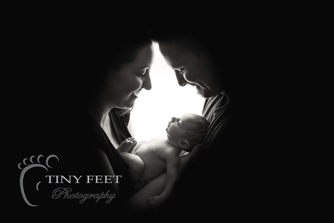 Tiny Feet Photography black and white shot of baby posed with mum and dad