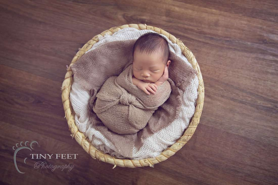 Tiny Feet Photography Newborn baby boy posed in basket
