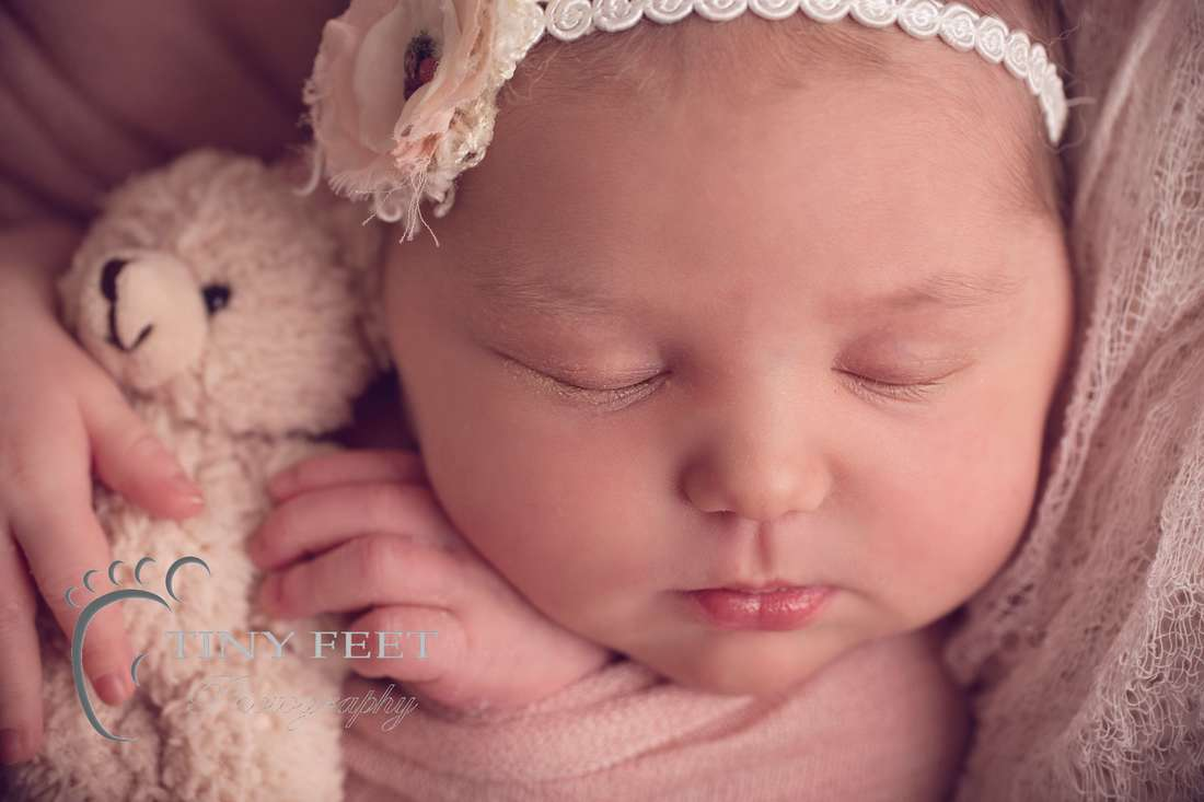 Tiny Feet Photography Perth newborn girl posed close up shot of face and features.