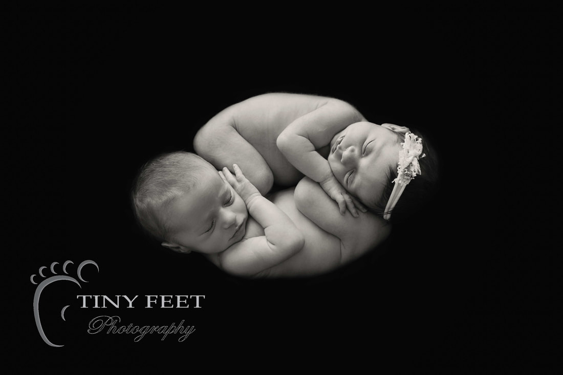 Tiny Feet Photography newborn twins in black and white womb pose