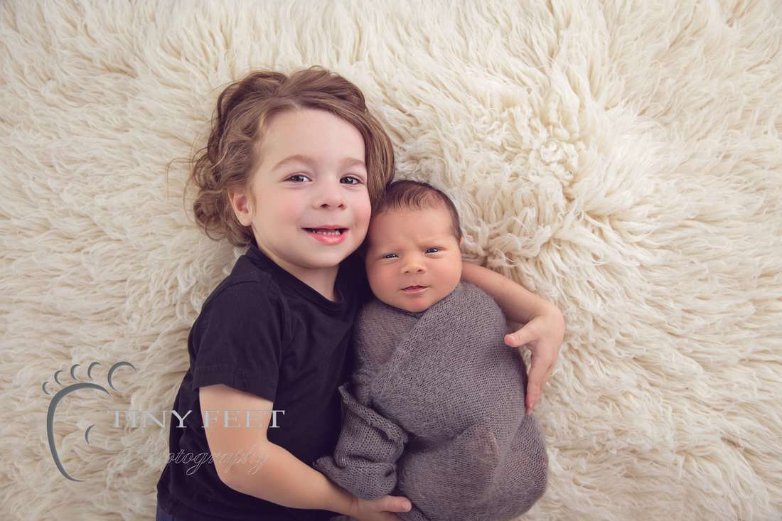 Tiny Feet Photography Newborn baby boy posed with sibling