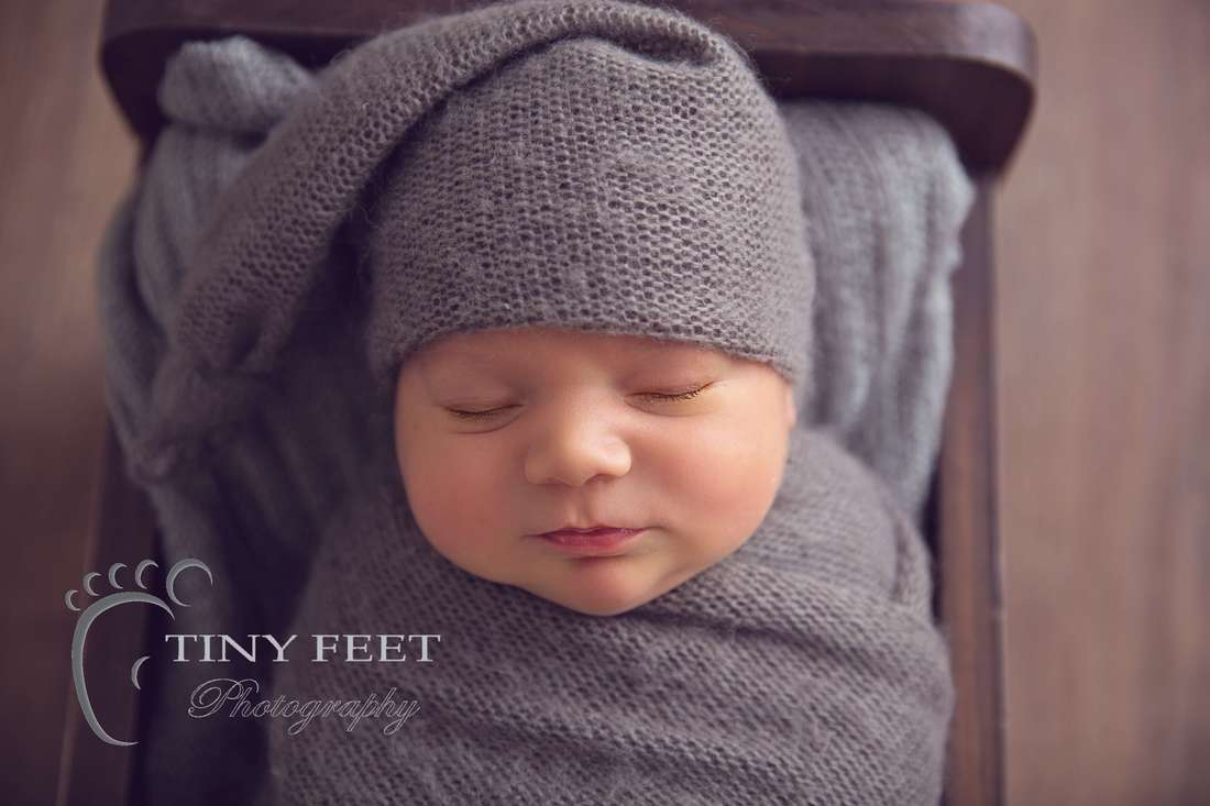 Tiny Feet Photography newborn baby boy wrapped and posed in Little Jar Big dreams wooden bed