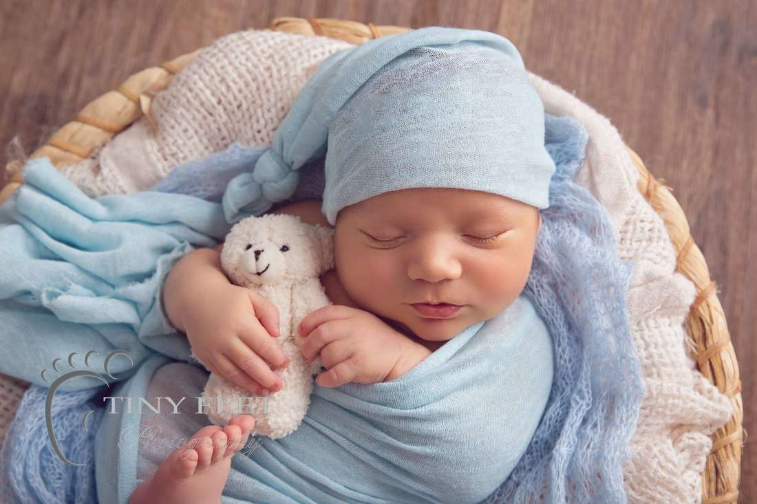 Tiny Feet Photography newborn baby boy wrapped in blue posed in bowl