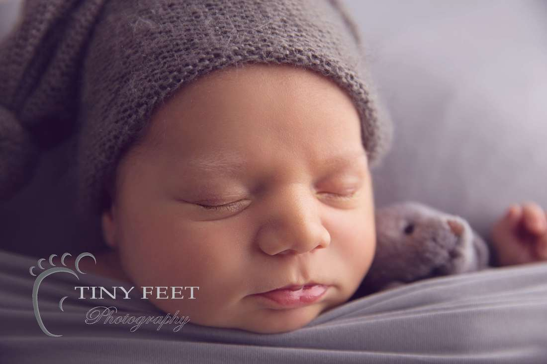 Tiny Feet Photography newborn baby close up shot of baby features