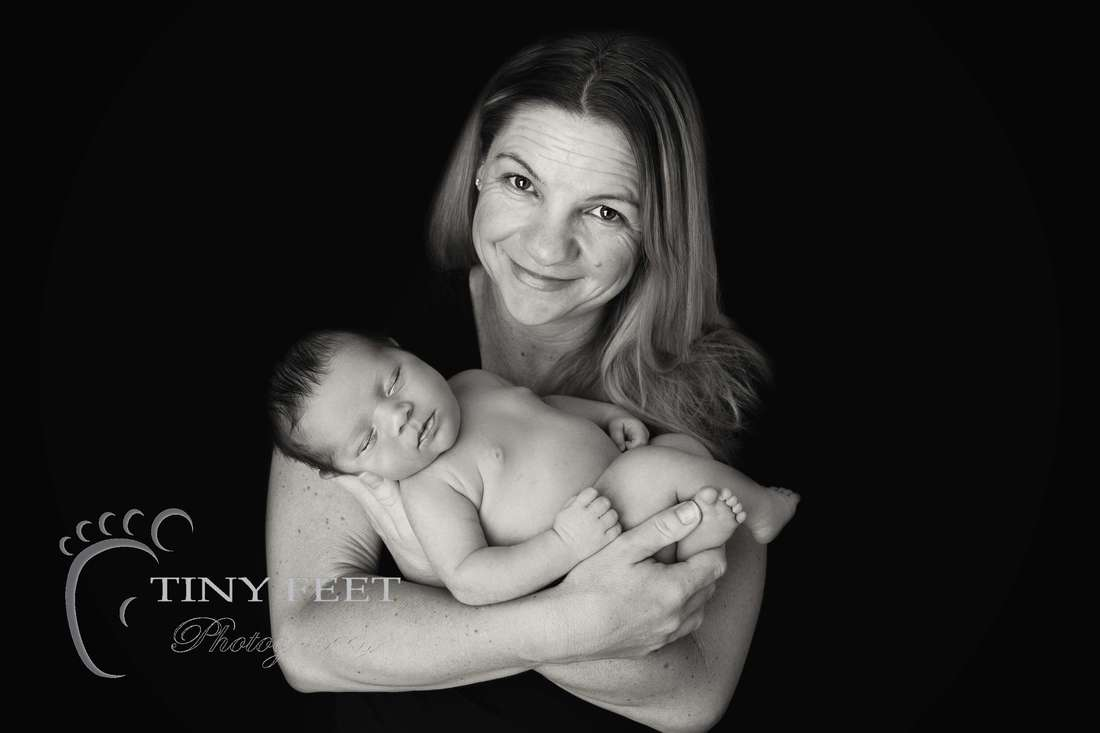 Tiny Feet Photography black and white image of newborn baby boy posed with mum