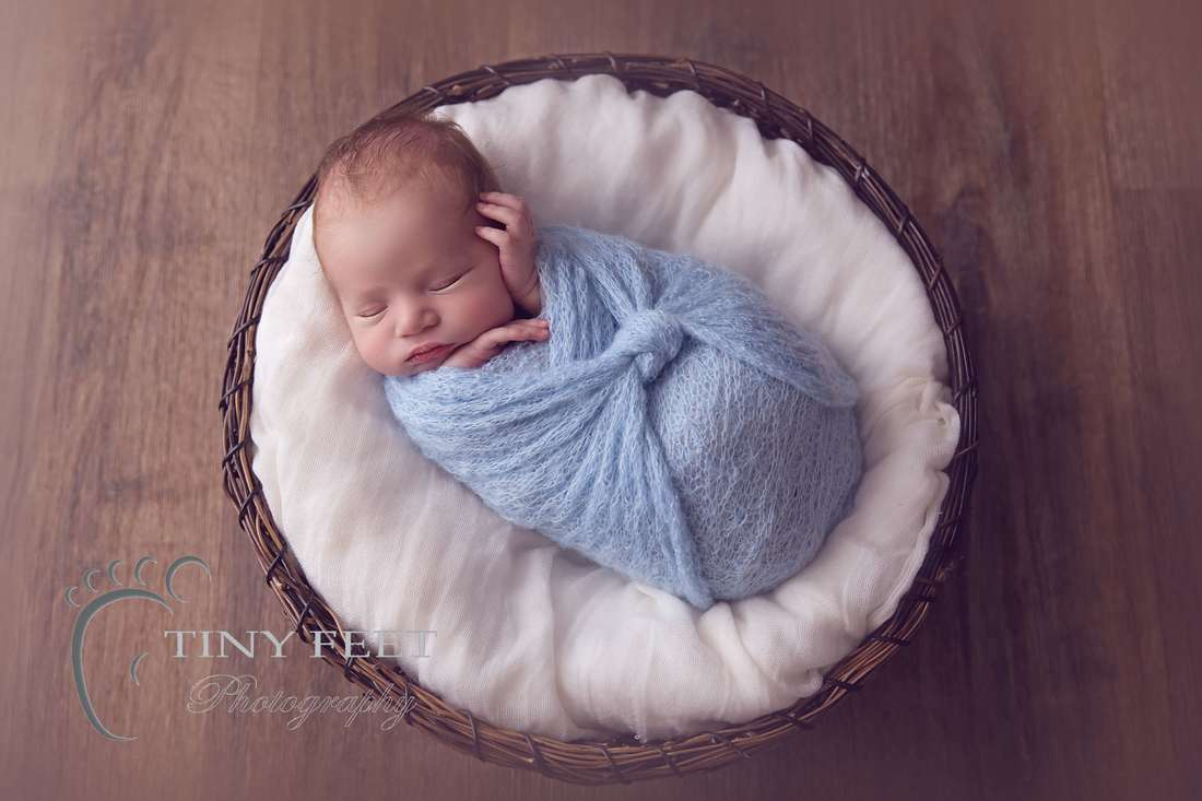 Tiny Feet Photography, newborn baby boy wrapped in blue in brown bowl