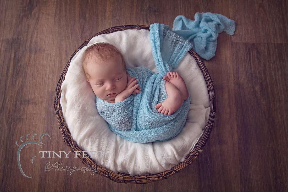 Tiny Feet Photography, newborn baby boy wrapped in blue wrap in a bowl