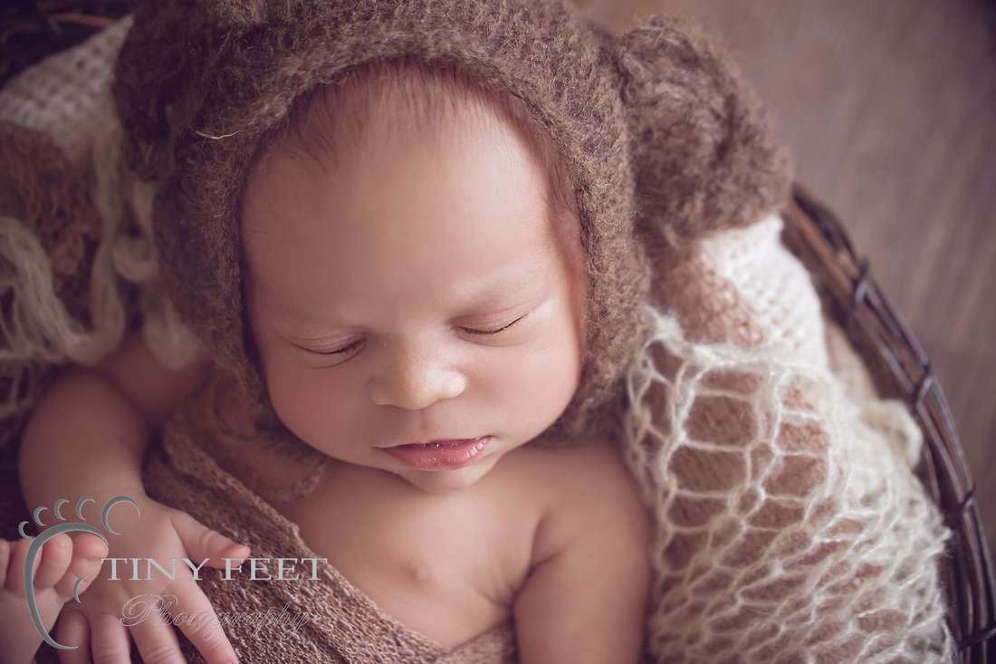 Tiny Feet Photography Newborn boy posed in basket