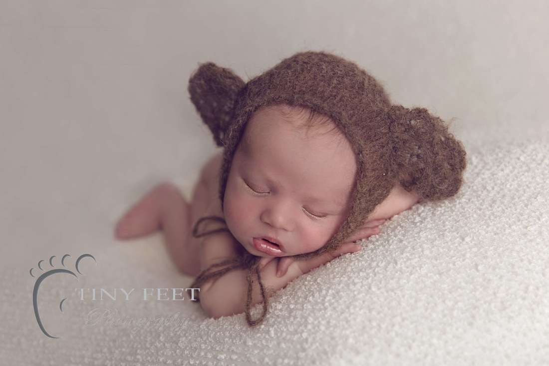 Tiny Feet Photography, newborn baby boy posed on beanbag