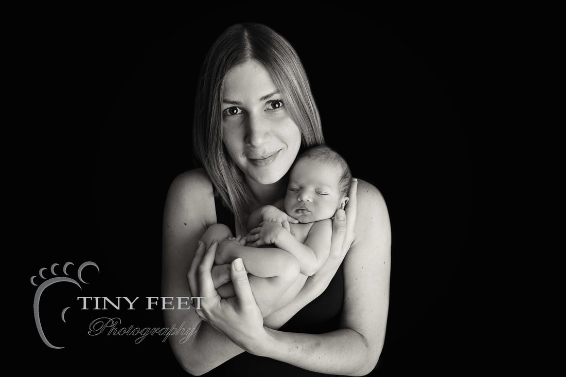 Tiny Feet Photography, newborn baby boy posed in mums arms in black and white