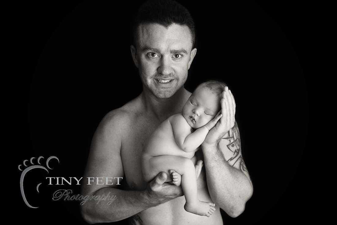 Tiny Feet Photography, newborn baby boy posed with dad in black and white
