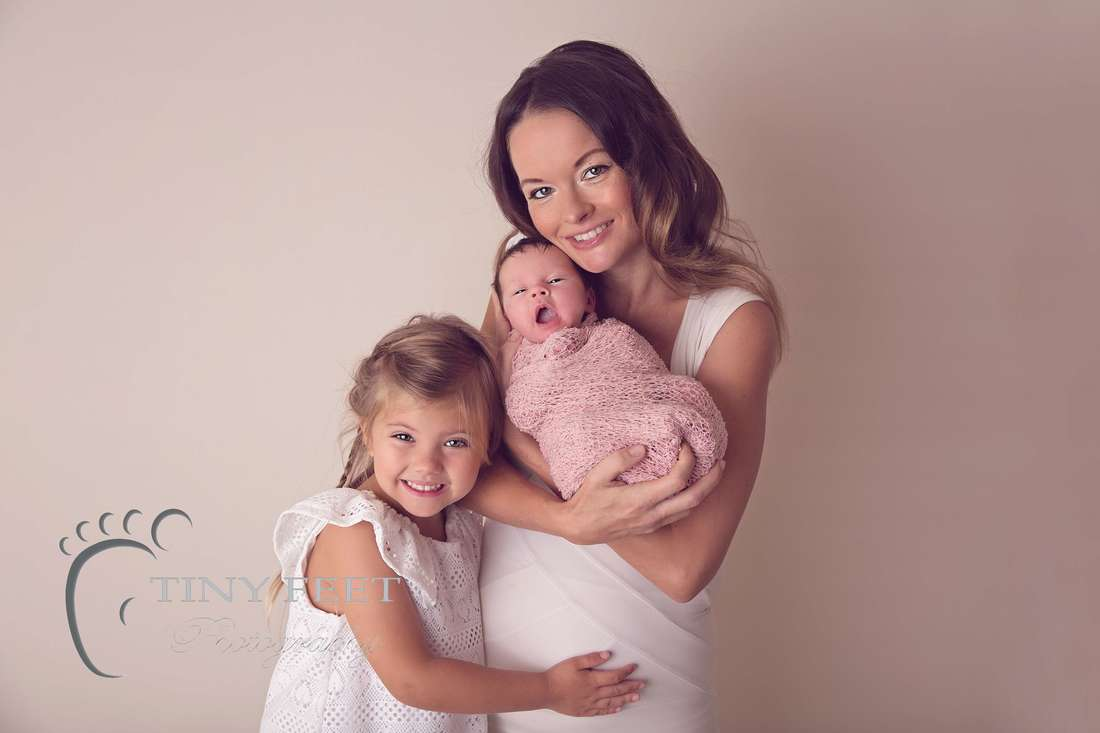 Tiny Feet Photography newborn baby girl wrapped in pink family posing