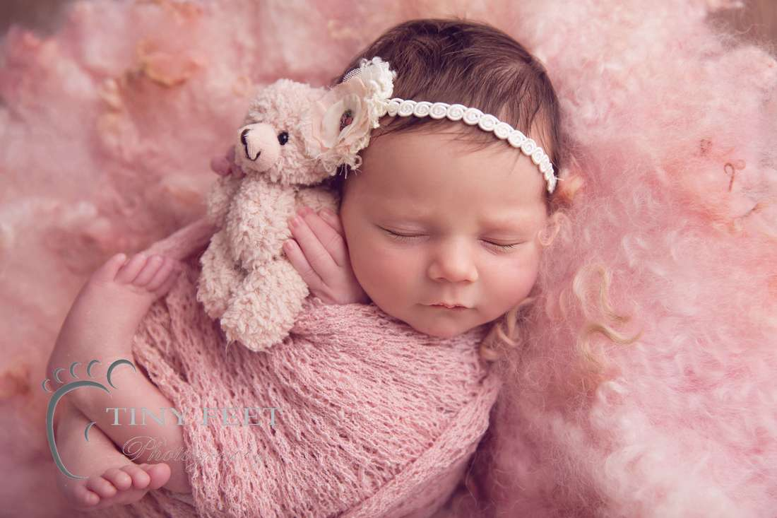 Tiny Feet Photography newborn baby girl in pink wrap with pink curly felt