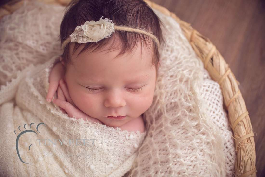Tiny Feet Photography newborn baby girl in cream wrap in cream basket