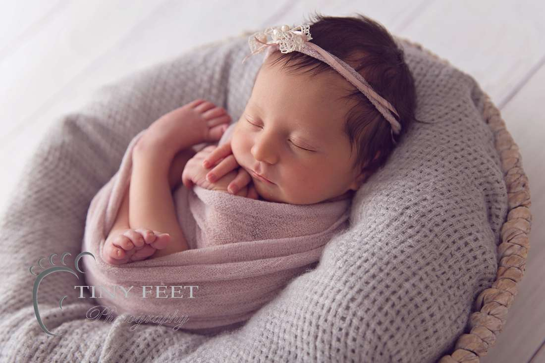 Tiny Feet Photography, newborn baby girl in pink wrap in a bowl back lit