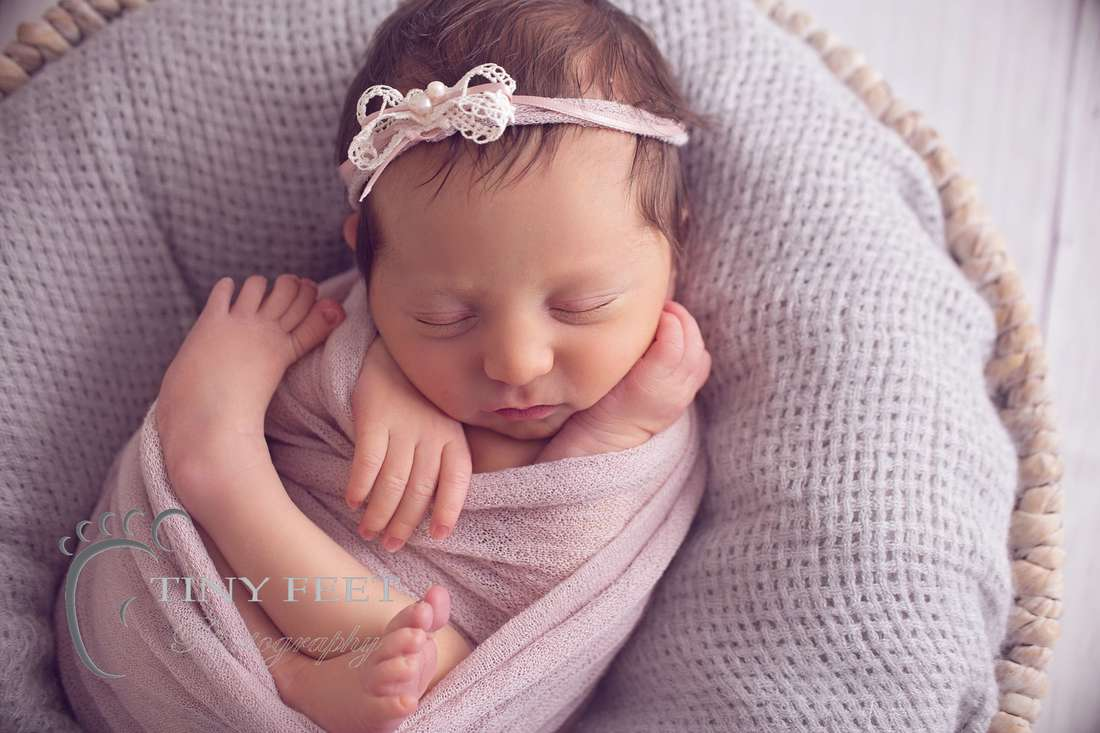 Tiny Feet Photography, newborn baby girl in pink wrap in a bowl