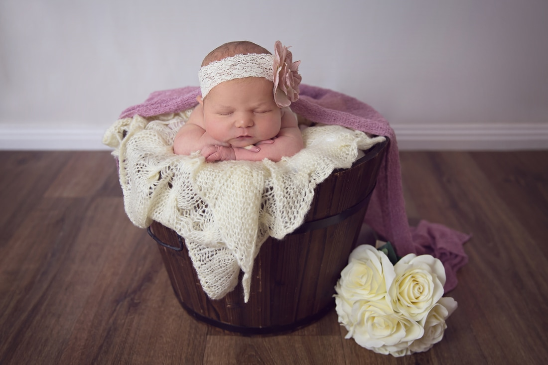 Tiny Feet Photography Newborn prop posing in bucket with flowers