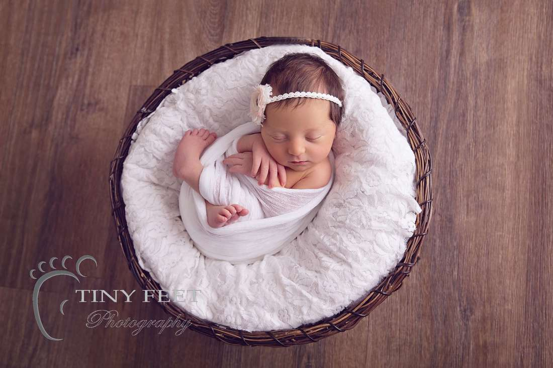 Tiny Feet Photography, newborn baby girl in white wrap in a bowl