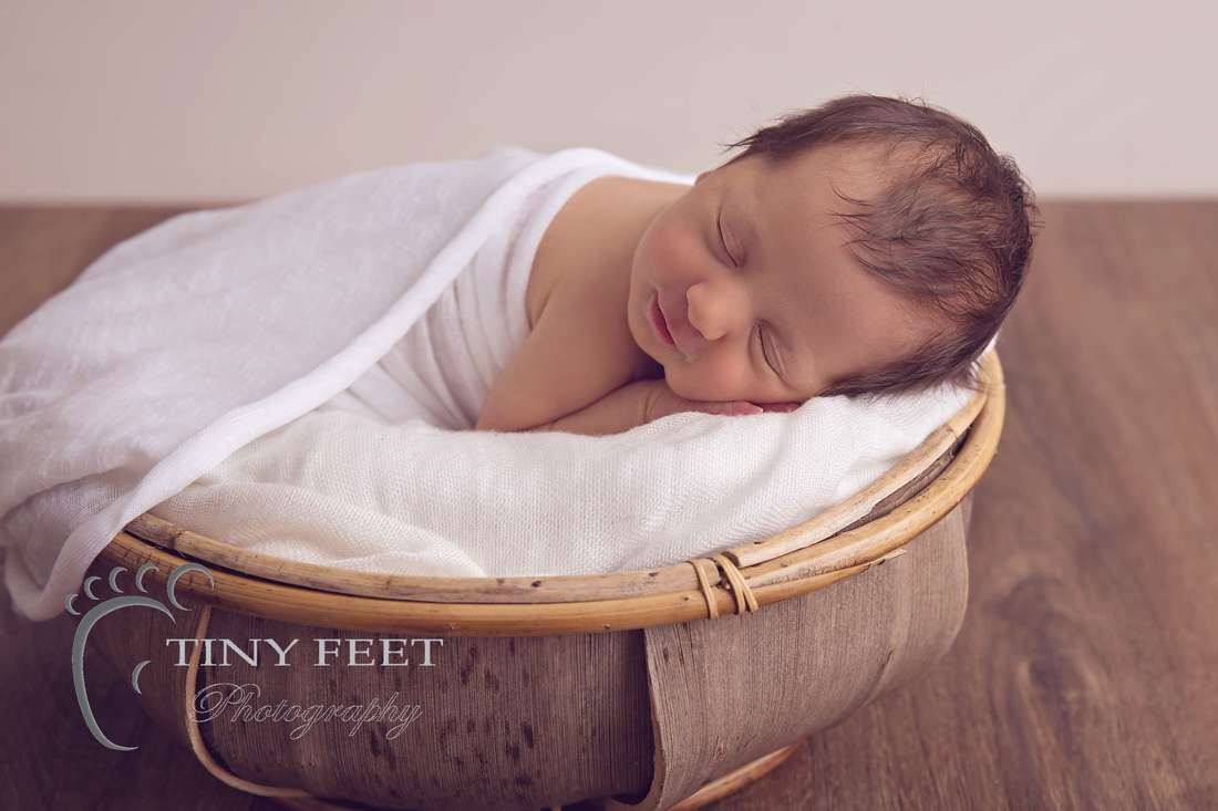 Tiny Feet Photography, newborn baby girl on tummy posed in coconut bowl