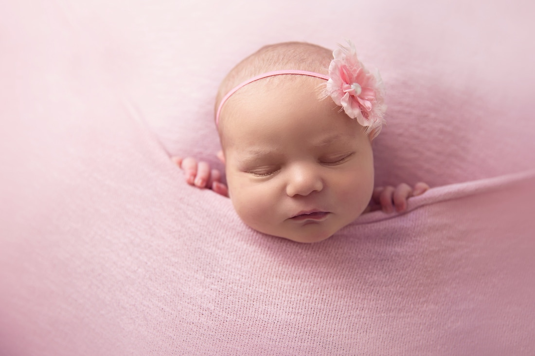 Tiny Feet Photography Newborn baby girl tucked in pink blanket