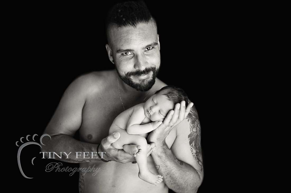 Tiny Feet Photography, newborn baby in black and white posed with dad