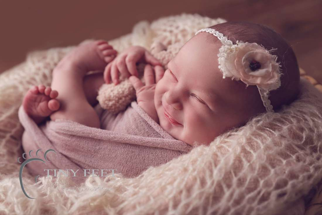Tiny Feet Photography baby girl backlit image of baby smiling