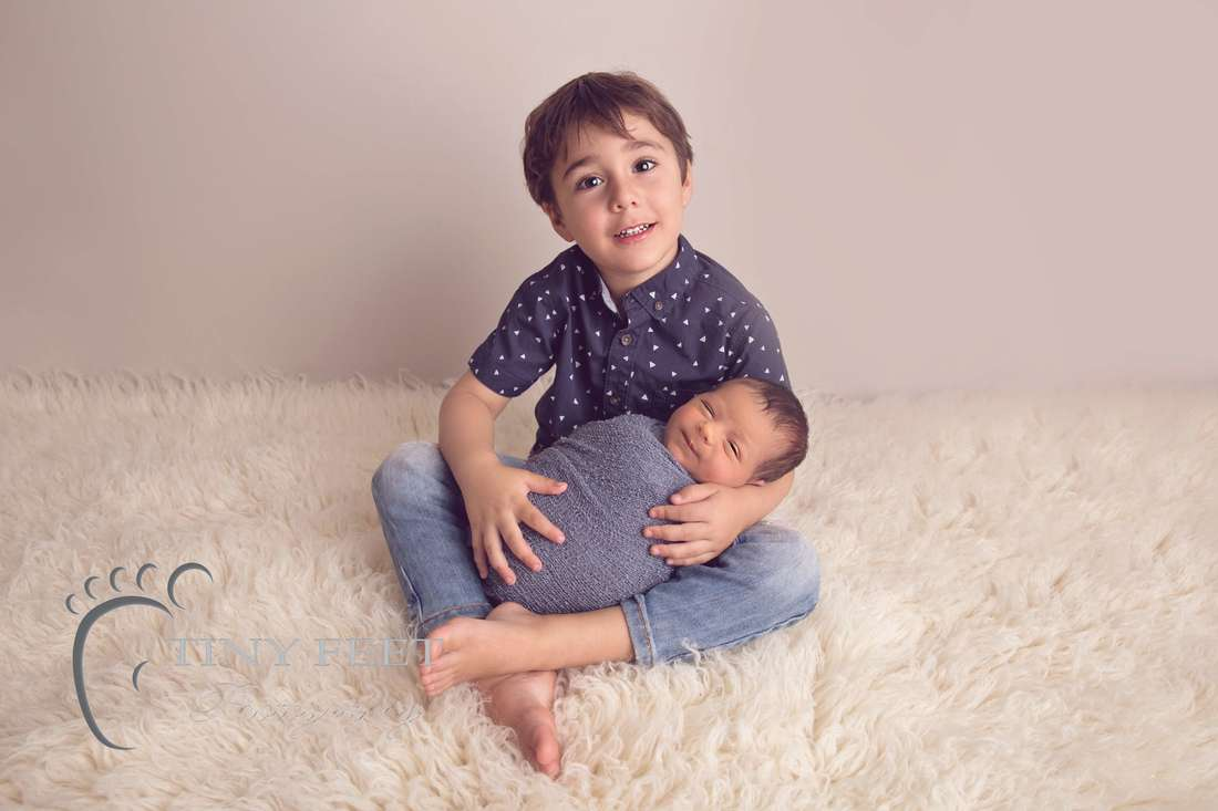 Tiny Feet Photography Newborn baby boy posed with 3 year old sibling
