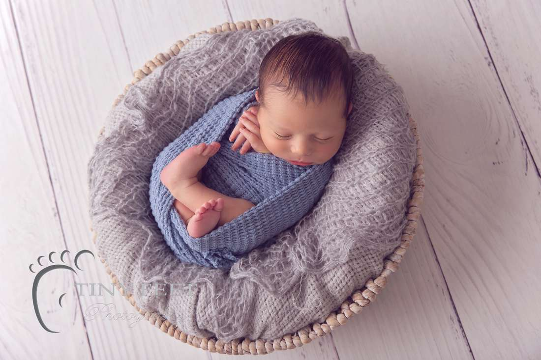 Tiny Feet Photography Newborn baby boy posed in blue wrap in bowl