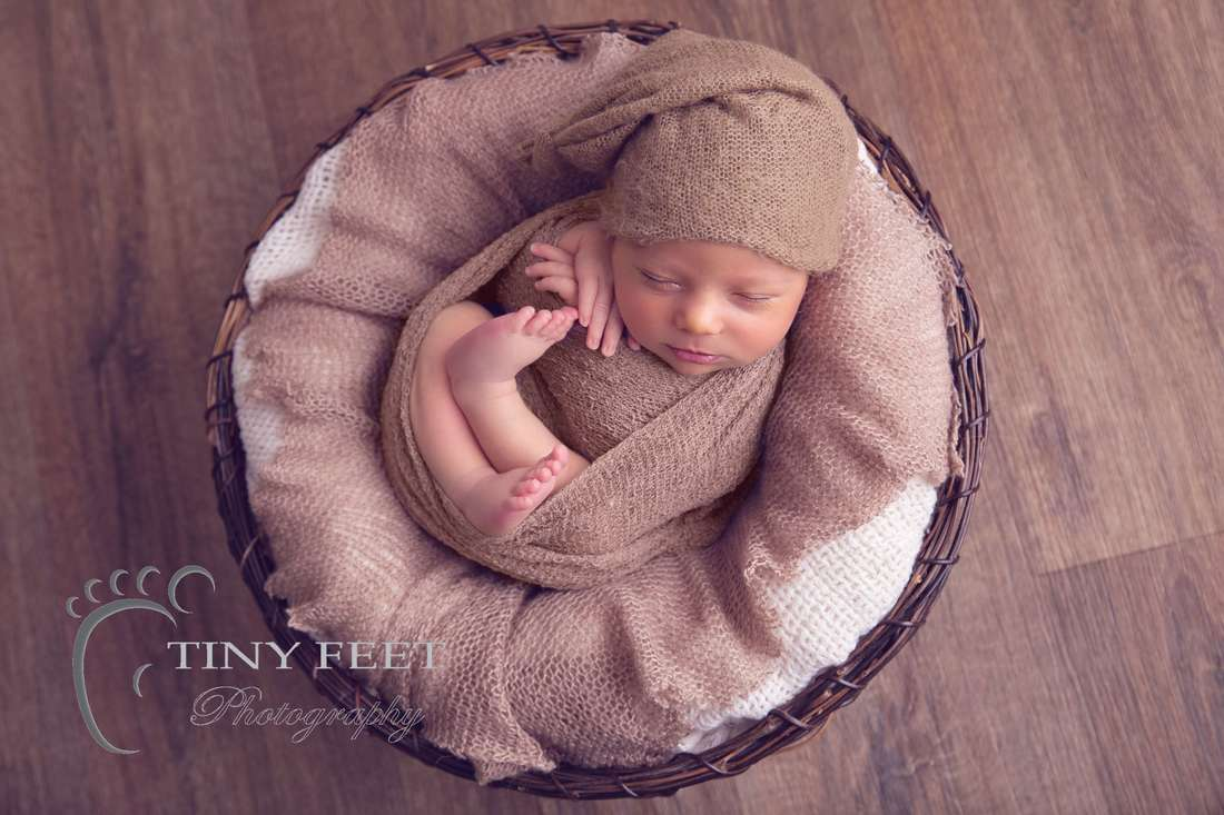 Tiny Feet Photography Newborn baby boy wrapped in brown in bowl