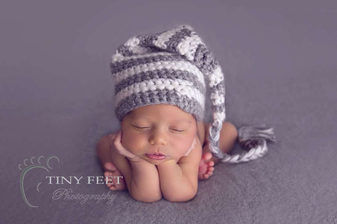 Tiny Feet Photography baby boy in froggy pose on grey blanket