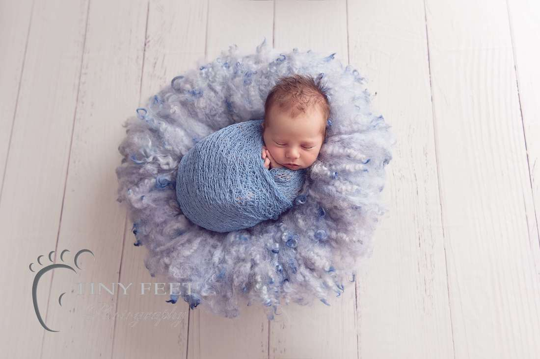 Tiny Feet Photography baby boy wrapped in blue wrap in bowl