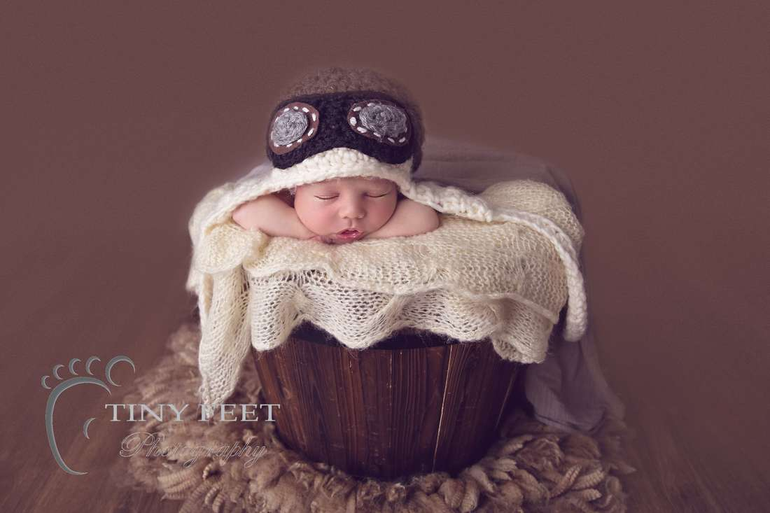 Tiny Feet Photography baby boy posed in chin on hands in bucket