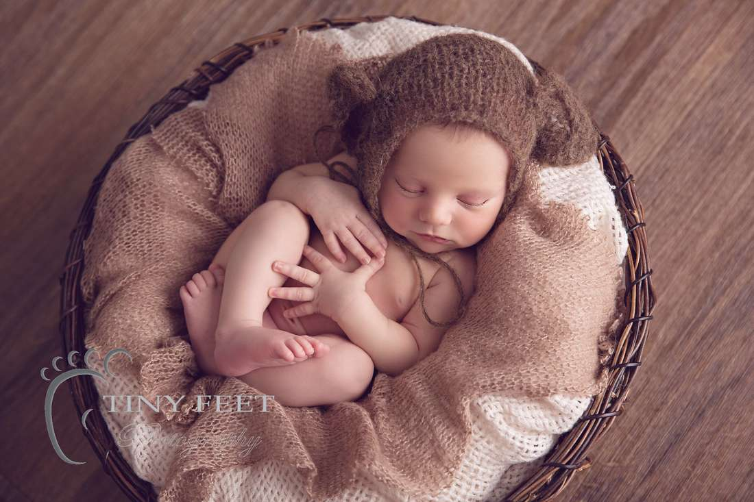 Tiny Feet Photography baby boy wrapped in brown wrap in bowl