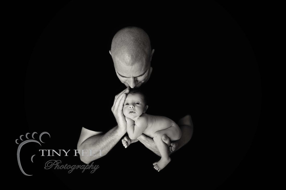 Tiny Feet Photography baby boy posed in dads hands