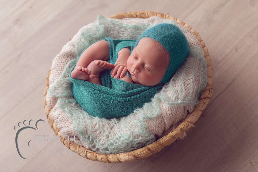 Tiny Feet Photography newborn baby boy in green wrap posed in bowl