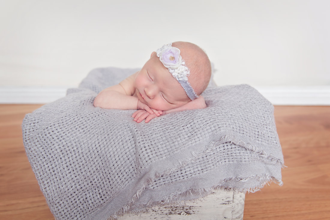 Tiny Feet Photography Newborn baby posing in basket
