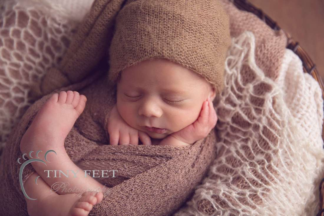 Tiny Feet Photography newborn boy posed in brown bowl