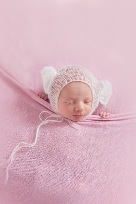 Tiny Feet Photography Newborn baby tucked in pose