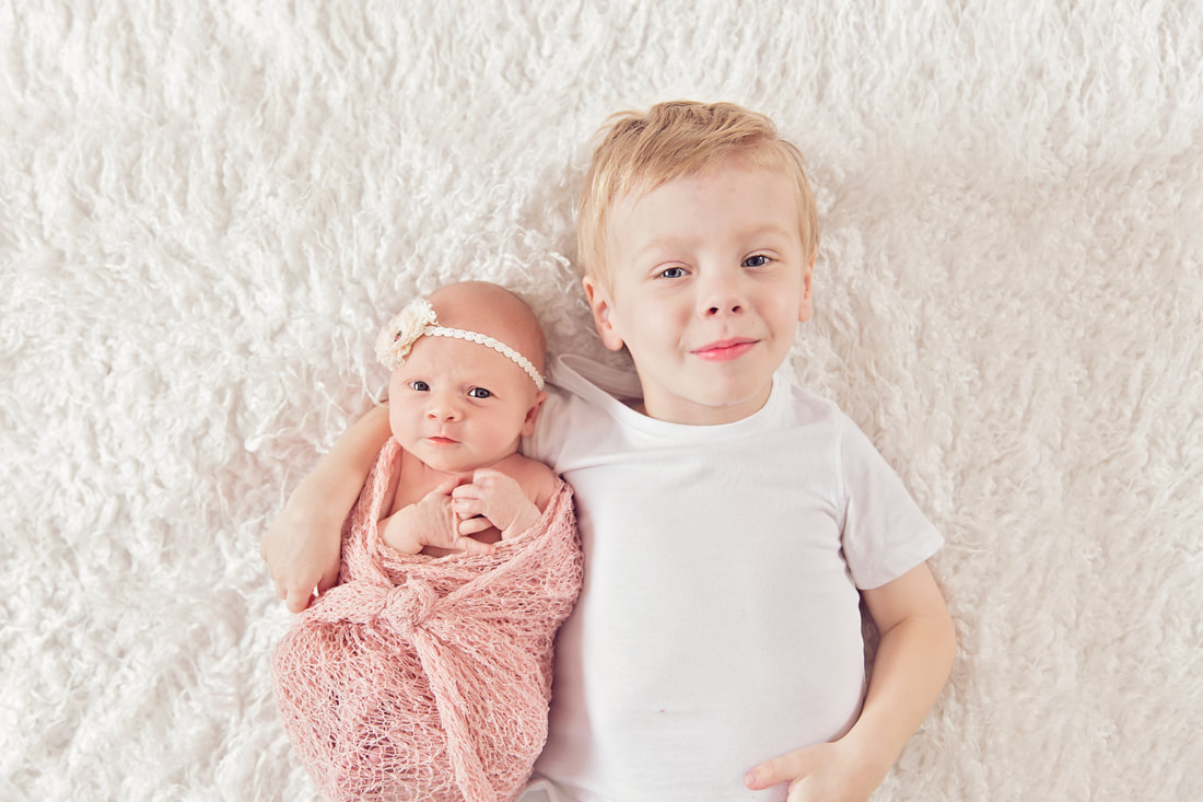 Tiny Feet Photography Newborn baby posing with  sibling