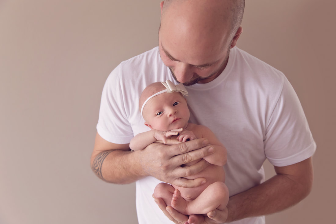 Tiny Feet Photography Newborn baby posing with dad