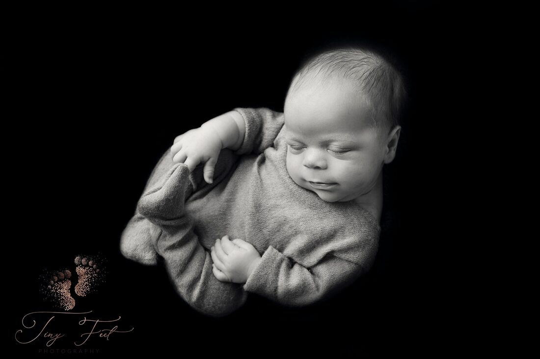 Tiny Feet Photography Newborn baby boy black and white in the womb pose